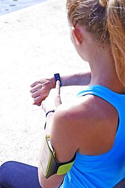 Woman checking her digital health tracker.