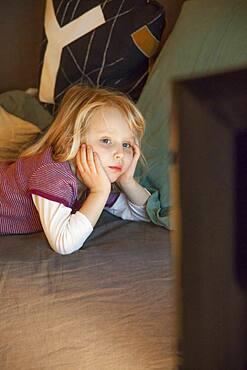 Child watching television.