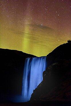 Northern Lights above Skogafoss waterfall, Iceland