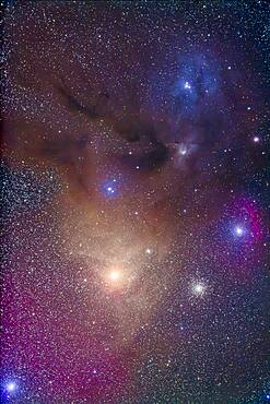 The colourful region around yellow Antares (bottom) in Scorpius and blue Rho Ophiuchi (top) in Ophiuchus. The nebulas are largely reflection nebulas, taking on the colour of the stars embedded in the nebulas. However, the field also contains a lot of emission nebulosity, hydrogen gas glowing red and magenta. Plus there are fingers of brown dark dusty nebulosity. It is one of the most colourful regions of the sky.