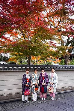 women dressed in kimono, street scene, Gion district, Kyoto, Japan.