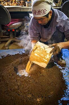 Takahiro Koizumi  is making mud to build a molds to make a iron teapot or tetsubin, nanbu tekki, Workshop of Koizumi family,craftsmen since 1659, Morioka, Iwate Prefecture, Japan