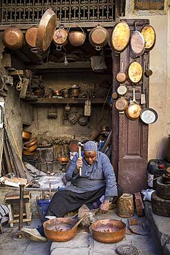 Metalworker, workshop in the Place as Seffarine. Fez.Morocco