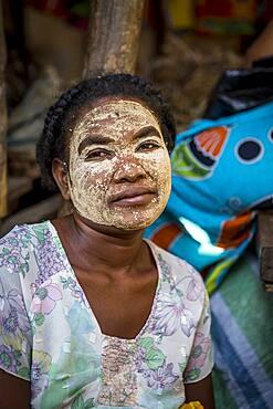 woman with traditional face mask,saleswoman, market, Morondava, Madagascar
