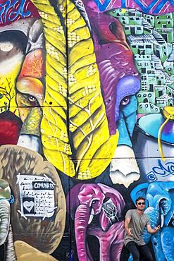 Tourist, Street art, mural, graffiti by Chota, Comuna 13, Medellín, Colombia