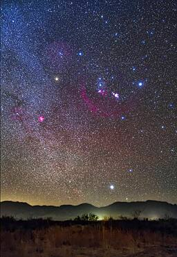 Orion and Sirius rising over the Peloncillo Mountains of southwest New Mexico, on a clear night in December in the early evening. The Belt stars of Orion point down to Sirius, the Dog Star.
