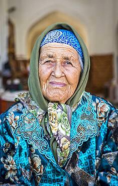 Umarova Saida, sunflower seeds vendor, in Taki-Telpak Furushon bazaar, Bukhara, Uzbekistan