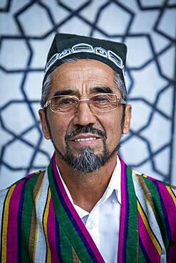 Poet, he sells his poems in the Courtyard of Ulugbek Medressa, Registan, Samarkand, Uzbekistan