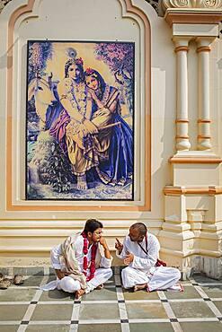 Believers speaking, in ISKCON temple, Sri Krishna Balaram Mandir,Vrindavan,Mathura, Uttar Pradesh, India