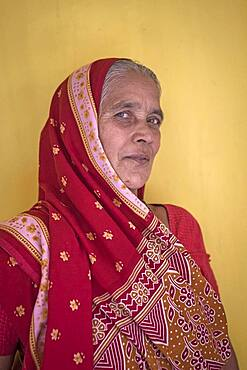 Mrs Parvathy (widow), in Ma Dham ashram for Widows of the NGO Guild for Service,the NGO proposes widows to wear colorful clothes, Vrindavan, Mathura district, India