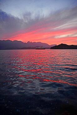Boat in Sea of Cortez at sunset, Baja California, Mexico