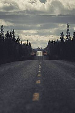 The roads north wind up and down soft hills. Yukon Territory, Canada