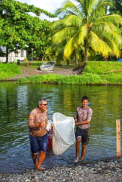 Fishers in Fautaua Valley. Les Rivières de Tahiti. Fauoro river in Teahupoo. Papeete Tahiti nui French Polynesia France