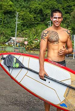 Surfer at Beach with black sand on Pointe Venus, Tahiti, French Polynesia, Tahiti Nui, Society Islands, French Polynesia, South Pacific.