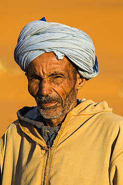 Camel driver portrait in the Erg Chebbi sand dunes