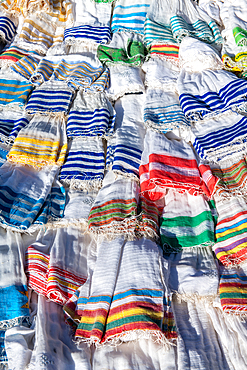 Scarves and textiles layered on top of one another for sale, Debre Berhan, Ethiopia
