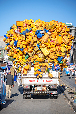 An Isuzu truck overloaded with plastic bottles and containers, Berhan, Ethiopia
