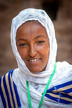 Portrait of an Ethiopian woman outside of Bet Medhane Alem (Church of the World Savior) in Lalibela, Ethiopia