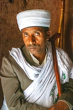 Portrait of a man inside the rock hewn monolithic church of Bet Giyorgis (Church of St. George) in Lalibela, Ethiopia