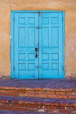 Turquoise blue doors of Old Town Emporium; Albuquerque, New Mexico.