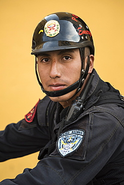 Policeman with national police force in Lima, Peru.