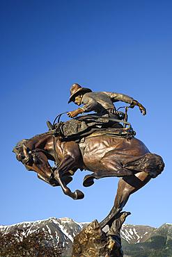 Attitude Adjustment bronze sculpture of cowboy and bucking bronco by Austin Barton in downtown Joseph, Oregon.
