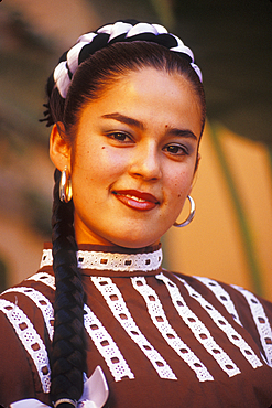 Young Mexican woman with folkloric dance group in traditional dress from Nuevo Leon area; Cabo San Lucas, Baja California Sur, Mexico.