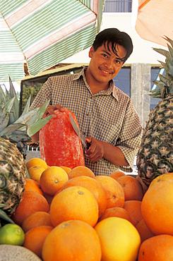 Street vendor with fruit cart in downtown Cabo San Lucas, Baja California Sur, Mexico.