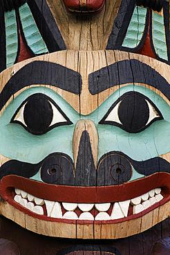 Detail of Tlingit totem pole at Saxman Totem Park, Ketchikan, Alaska.