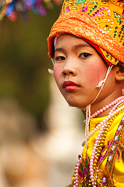Young boy of the Shan people from Burma about to become a novice monk during a ceremony at Wat Khun Thwong Buddhist temple in Chiang Mai, Thailand.