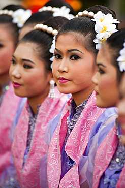 Young Thai women in traditional costume at Thailand Tourism Authority Golden Jubilee Grand Reception; Bangkok, Thailand.