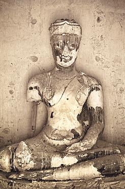 Ancient Buddha statue at Wat Chaiwatthanaram Buddhist temple ruins in Ayutthaya, Thailand.