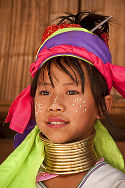 Young girl of the Karen hill tribe wearing traditional neck coil at Baan Tong Luang, a village of Hmong people in Chiang Mai Province, Thailand.