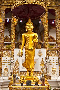Buddha statue at Wat Bupparam Buddhist temple; Chiang Mai, Thailand.