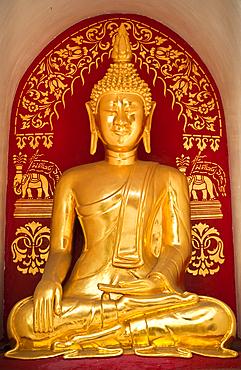 Golden Buddha statue at Wat Fon Soi Buddhist temple in Chiang Mai, Thailand.
