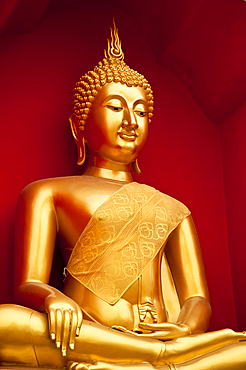 Golden Buddha statue at Wat Bupparam Buddhist temple in Chiang Mai, Thailand.