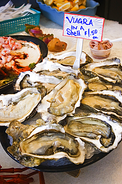 Viagra in a shell - fresh oysters for sale at fish market on Fisherman's Wharf, Monterey, California.