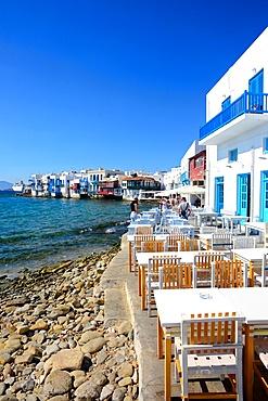 Cafe terrace with Little Venice in view, Mykonos, Greece