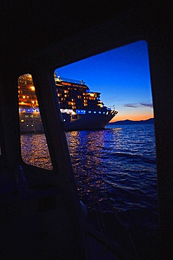 Boat that carries tourists from port of Mykonos to cruise ship, Greek Islands, Greece