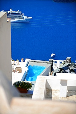 Building roofs and cruise ships in Fira, Santorini, Greek Islands, Greece
