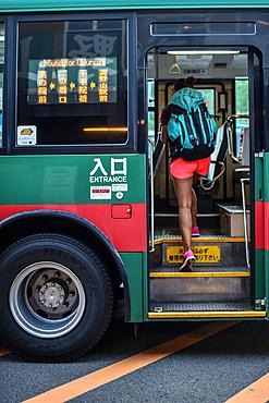Young traveler woman boarding bus in Koyasan, Japan