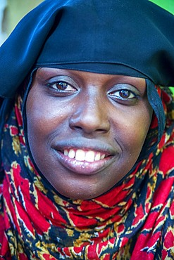 Funy swahili woman portrait in the strees of the city town of Lamu in Kenya
