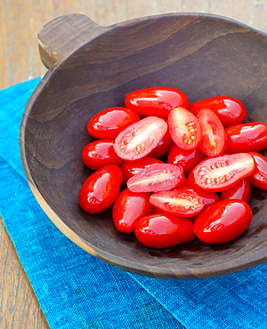 cherry tomato in a wooden bowl