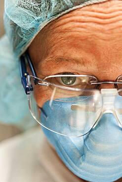 Scientist in necropsy lab wearing safety equipment