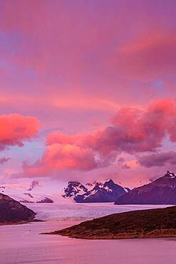 Pink skies before sunrise over the Perito Moreno Glacier in Los Glaciares National Park near El Calafate, Argentina.  A UNESCO World Heritage Site in the Patagonia region of South America.