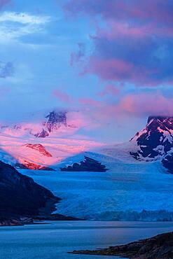 A pastel sunrise over the Perito Moreno Glacier in Los Glaciares National Park near El Calafate, Argentina.  A UNESCO World Heritage Site in the Patagonia region of South America.