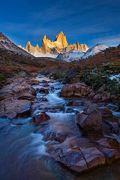 The Fitz Roy Massif at the first light of sunrise.  Los Glaciares National Park near El Chalten, Argentina.  A UNESCO World Heritage Site in the Patagonia region of South America.  Mount Fitz Roy is in the tallest peak in the center.  The creek in the foreground is the Arroyo del Salto.