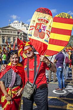 Anti-independence Catalan protestors carry Spanish and catalan flag during a demonstration for the unity of Spain on the occasion of the Spanish National Day at Passeig de Gracia, Barcelona on October 12, 2014, Spain