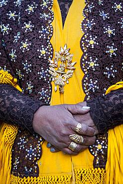 Angela la Folclorista, detail of her dress and hands, cholita female wrestler, El Alto, La Paz, Bolivia