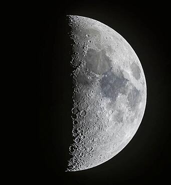 A panorama of the 7-day-old first quarter Moon on March 13, 2019, showing the full disk and extent of incredible detail along the terminator, the dividing line between the day and night sides of the Moon where the Sun is rising as seen from the surface of the Moon. Note the tiny points of light at the centres of some of the craters (particularly Alphonsus and Arzachel below centre) in the Southern Highlands from sunlight just catching the central peaks of those craters. At top in the north the slash of the Alpine Valley is obvious as well as the curve of the Apennine Mountains.
